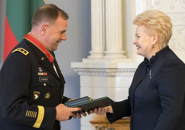 Lithuanian President Dalia Grybauskaite, right, presents the State Awards of the Republic of Lithuania, the Cross of Commander of the Order for Merits to Lithuania, to Commander of U.S. Army Europe Lt. Gen. Ben Hodges during a ceremony at the President's palace in Vilnius, Lithuania