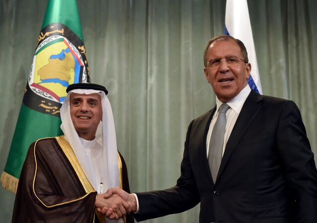 Russian Foreign Minister Sergei Lavrov (R) shakes hands with Saudi Arabia's Foreign Minister Adel al-Jubeir during a joint press conference following Sergei Lavrov's meeting with foreign ministers of the Gulf Cooperation Council (GCC) in Moscow