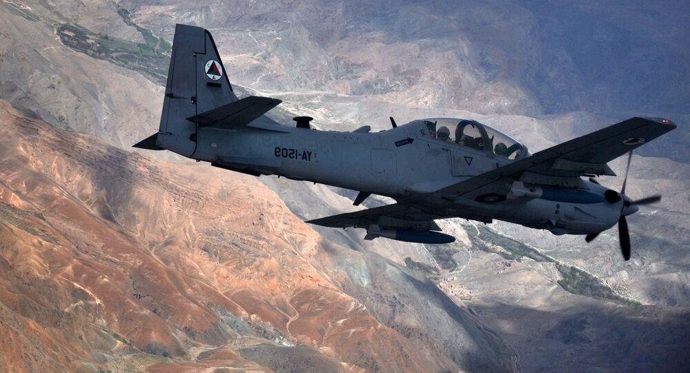 An A-29 Super Tucano flies over Afghanistan.