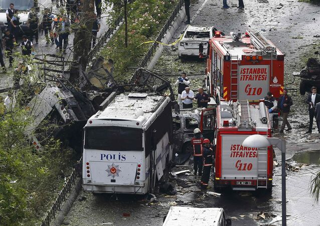 Fire engines stand beside a Turkish police bus which was targeted in a bomb attack in a central Istanbul district, Turkey, June 7, 2016.