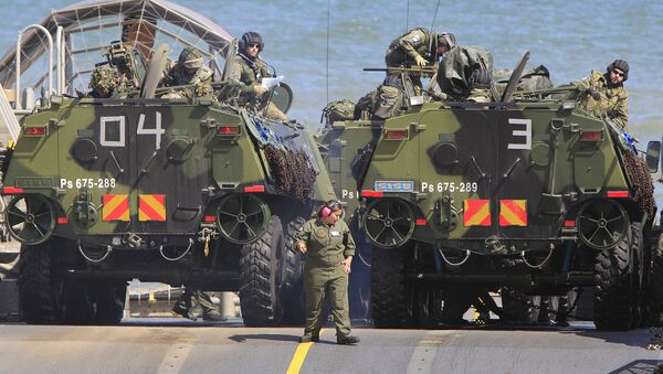 Soldiers park their amphibious vehicles on a ship as they participate in a massive amphibious landing during NATO sea exercises BALTOPS 2015 that are to reassure the Baltic Sea region allies in the face of a resurgent Russia, in Ustka, Poland, Wednesday, June 17, 2015 - Sputnik International