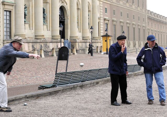 Elderly residents play petanque outside the Royal Castle in Stockholm
