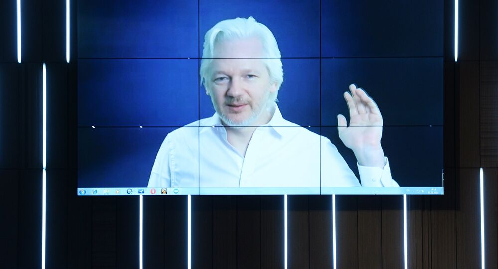 A video link up with Julian Assange, journalist, founder and editor-in-chief of WikiLeaks, at the session, End of the Monopoly: The Open Information Age, held as part of the New Era of Journalism: Farewell to Mainstream international media forum at the Rossiya Segodnya International Multimedia Press Center
