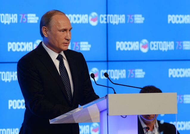 Russian President Vladimir Putin speaks at the New Era of Journalism: Farewell to Mainstream international media forum at the Rossiya Segodnya International Multimedia Press Center