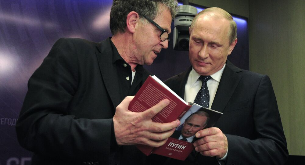 June 7, 2016. Right: Russian President Vladimir Putin, right, during presentation of the book Putin: the Logic of Power by German journalist Hubert Seipel during the International Media Forum New Era of Journalism: Farewell to Mainstream. at the International Multimedia Press Center of the Rossiya Segodnya International Information Agency. Left: Hubert Seipel, a journalist with Germany's ARD / NDR television & radio companies.