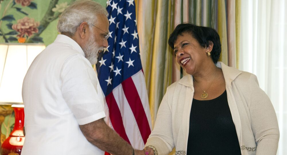 Attorney General Lorreta Lynch, right, and Indian Prime Minister Narendra Modi shake hands during a ceremony marking the repatriation of over 200 artifacts to the Indian government, at Blair House in Washington, Monday, June 6, 2016.