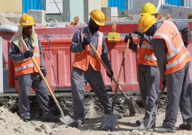 Workers are seen at a construction site in Doha, on November 16, 2014.