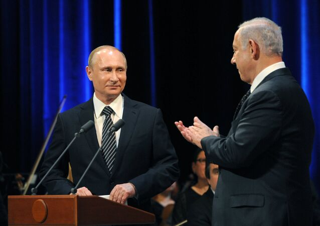 June 7, 2016. Russian President Vladimir Putin (left) and Israeli Prime Minister Benjamin Netanyahu before a concert devoted to the 25th anniversary of the restoration of Russian-Israeli diplomatic relations in the Bolshoi Theater, Moscow.