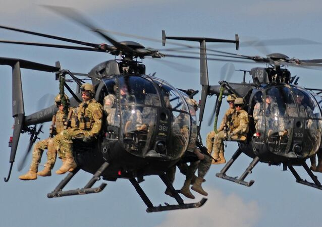 Boeing AH-6 helicopters bring in ground troops