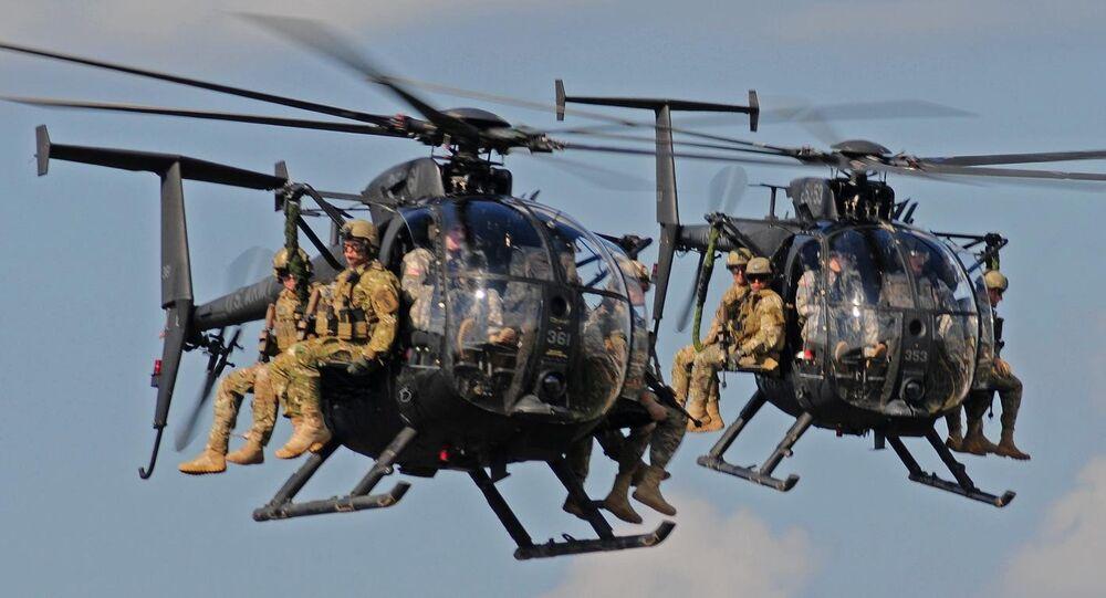 Boeing AH-6 helicopters bring in ground troops