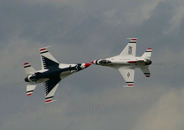 Two F-16's Barely Miss Colliding during a Georgia air show on May 5, 2009.