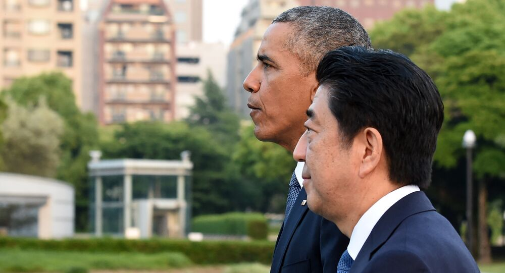 US President Barack Obama (L) and Japanese Prime Minister Shinzo Abe (R) walk towards the Atomic Bomb Dome after laying wreath in the Peace Momorial park in Hiroshima on May 27, 2016
