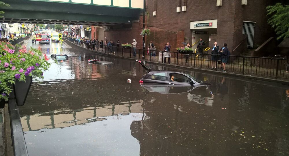 Cars are seen submerged in deep water on a flooded street in London on June 7, 2016, in this handout picture from London Fire Brigade