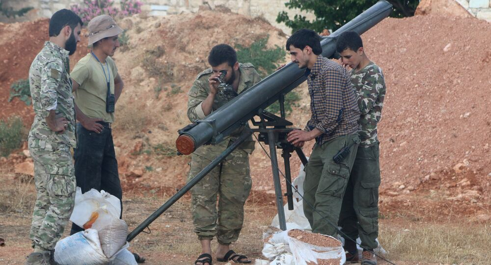 Rebel fighters from the First Regiment, part of the Free Syrian Army, prepare to fire a Grad rocket from Aleppo's Al-Haidariya neighbourhood, towards forces loyal to Syria's President Bashar al-Assad stationed in Talet al-Sheikh Youssef, Syria May 29, 2016