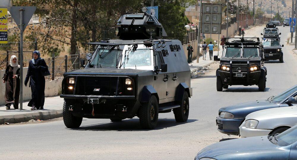 Jordanian security vehicles seen near the General Intelligence directorate offices near al Baqaa Refugee Camp, north of Amman, Jordan, June 6, 2016