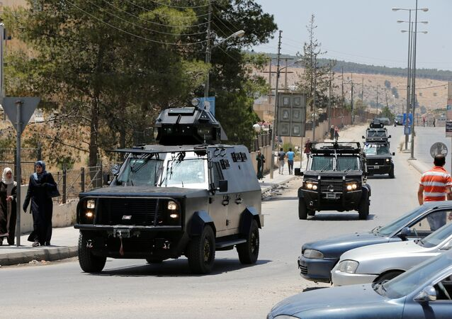 Jordanian security vehicles seen near the General Intelligence directorate offices near al Baqaa Refugee Camp, north of Amman, Jordan, June 6, 2016