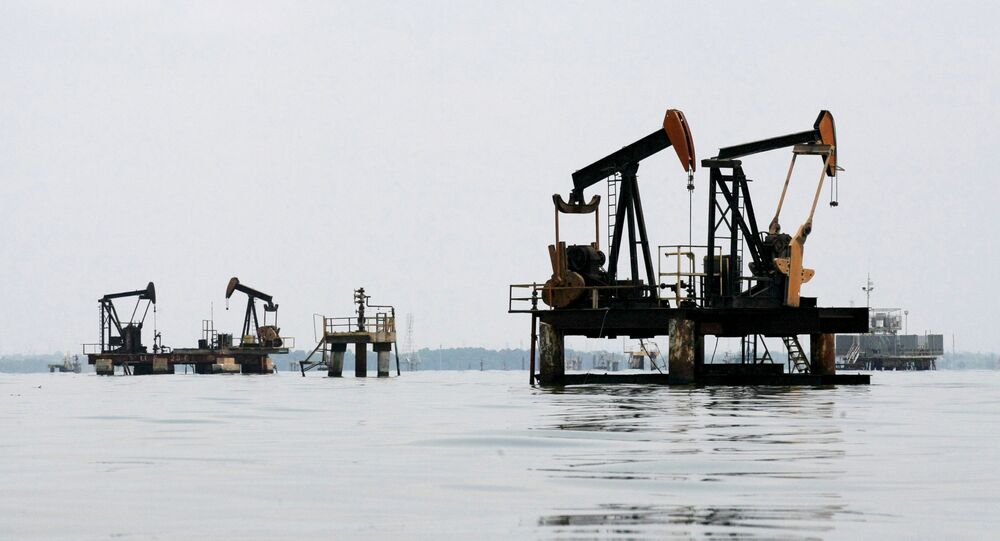 Oil pumps are seen in Lake Maracaibo, in Lagunillas, Ciudad Ojeda, in the state of Zulia, Venezuela, March 20, 2015