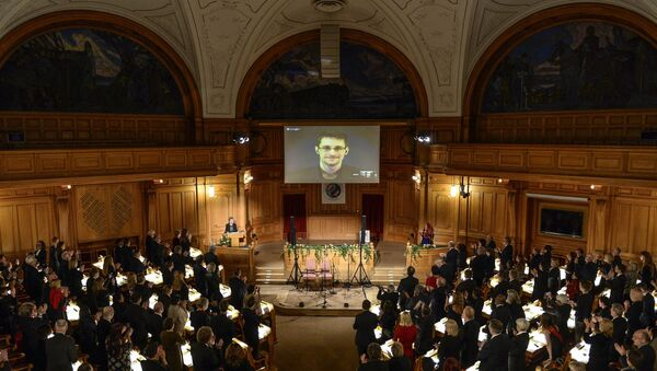 Fugitive US intelligence leaker Edward Snowden is shown on a livestream from Moscow during the Right Livelihood Award ceremony at the Swedish Parliament, in Stockholm, on December 1, 2014 - Sputnik International
