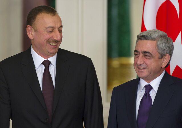 Azerbaijan President Ilkham Aliyev and Armenian President Serzh Sargsyan. File photo