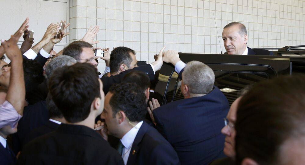 Turkish President Tayyip Erdogan (R) departs after the jenazah, an Islamic funeral prayer, for the late boxing champion Muhammad Ali in Louisville, Kentucky, the US, June 9, 2016