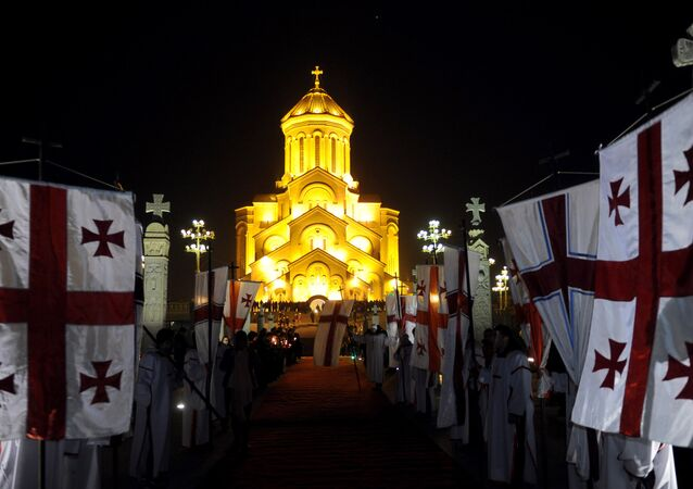 Georgian Orthodox Christians gather in front of the Trinity Cathedral during a Christmas Mass in Tbilisi early on January 7, 2015