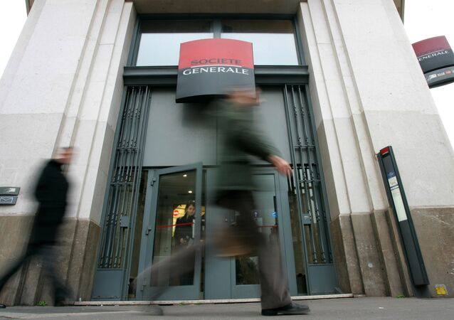 Pedestrians walk past a branch office of French bank Societe Generale (File)