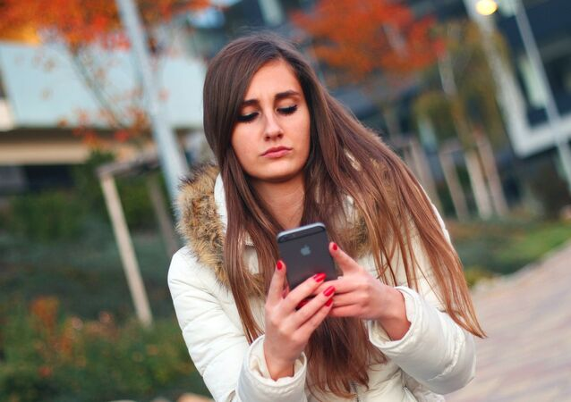 A young girl using her smartphone.