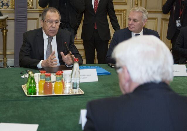 French Foreign Minister Jean-Marc Ayrault (Rear), Russian Foreign Minister Sergei Lavrov (Rear L) and German Foreign Minister Frank-Walter Steinmeier (Front) are pictured before a joint meeting on the situation in Ukraine with their Ukrainian counterpart at the French Foreign Ministry in Paris on March 3, 2016