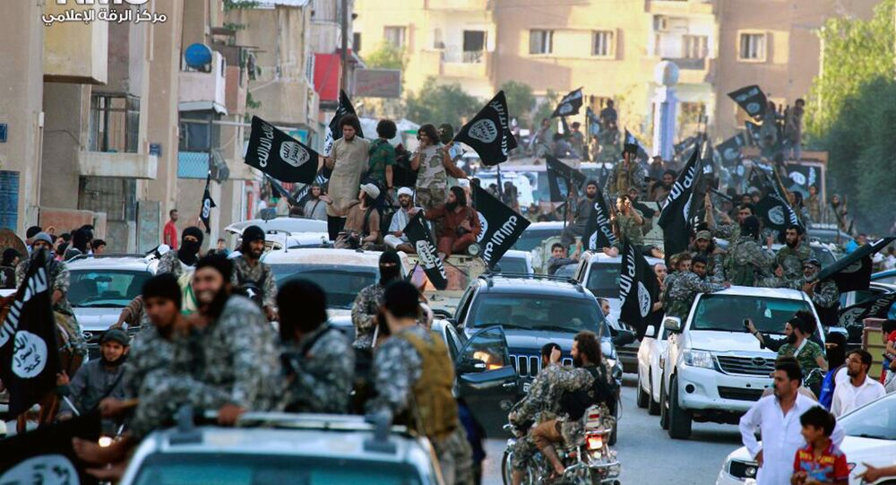 In this undated file image posted on Monday, June 30, 2014, by the Raqqa Media Center of the Islamic State group, a Syrian opposition group, which has been verified and is consistent with other AP reporting, fighters from Daesh group parade in Raqqa, north Syria