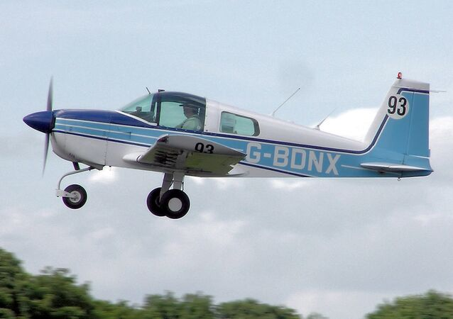 1975 Grumman AA-1B Trainer taking off.