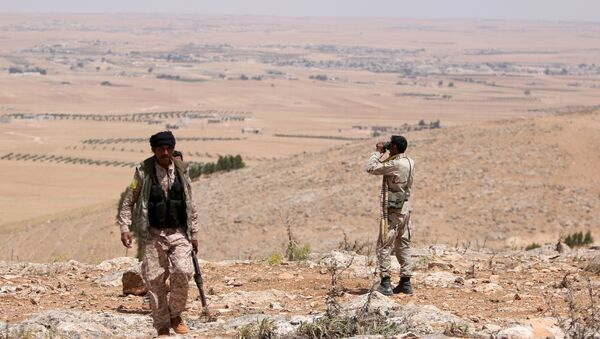 Manbij Military Council fighters take an overwatch position in the southern rural area of Manbij, in Aleppo Governorate, Syria. file photo - Sputnik International