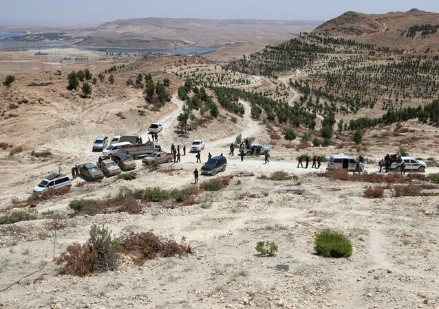 Fighters of the Manbij Military Council and the Syrian Democratic Forces gather in the southern rural area of Manbij, in Aleppo Governorate, Syria. file photo