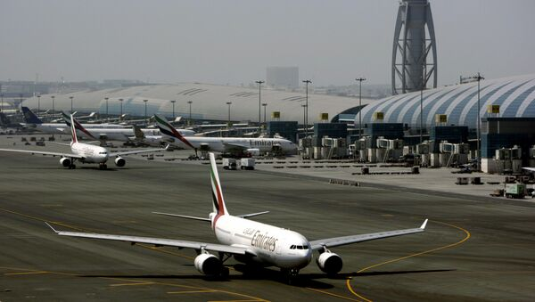 In Tuesday April 20, 2010 file photo, an Emirates airline passenger jet taxis on the tarmac at Dubai International airport in Dubai, United Arab Emirates - Sputnik International