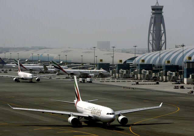 In Tuesday April 20, 2010 file photo, an Emirates airline passenger jet taxis on the tarmac at Dubai International airport in Dubai, United Arab Emirates