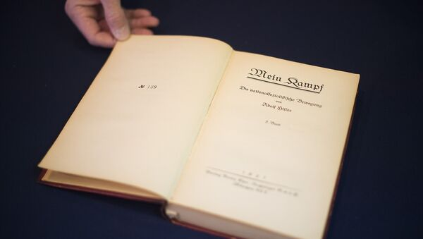 A copy of Nazi leader, Adolf Hitler's, political manifesto Mein Kampf, discovered at his Munich apartment and signed by eleven American officers, is on display March 18, 2016 before auction at Alexander Historical Auctions in Chesapeake City, Maryland - Sputnik International