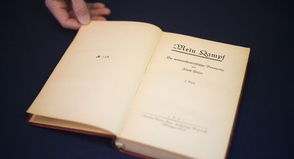 A copy of Nazi leader, Adolf Hitler's, political manifesto Mein Kampf, discovered at his Munich apartment and signed by eleven American officers, is on display March 18, 2016 before auction at Alexander Historical Auctions in Chesapeake City, Maryland