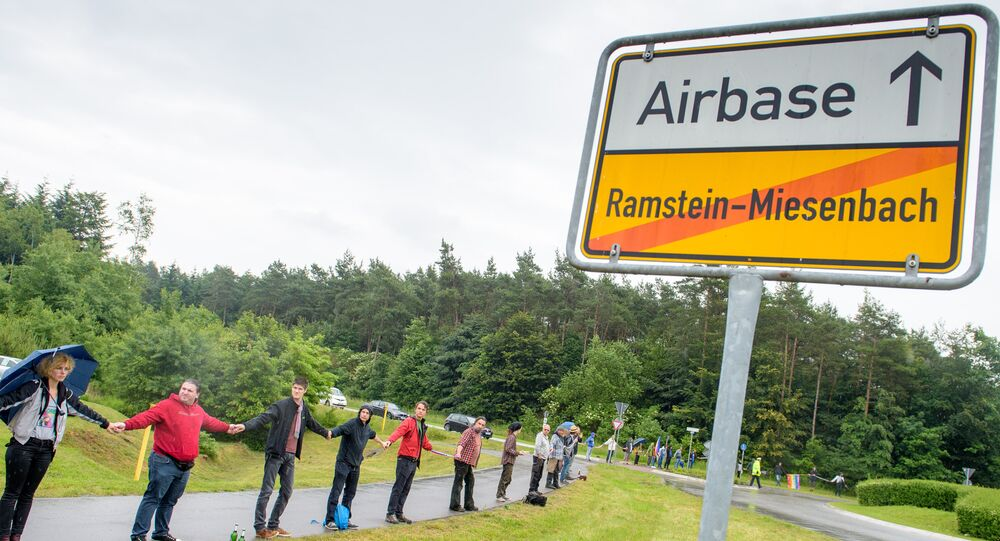 Activists attend a rally Stop-Ramstein on the road leading to US Air Force Base in Ramstein-Miesenbach on June 11, 2016