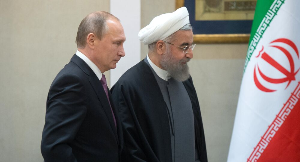 Russian President Vladimir Putin (left) and President of the Islamic Republic of Iran Hassan Rouhani at a news conference following the Russian-Iranian talks in Tehran (File)