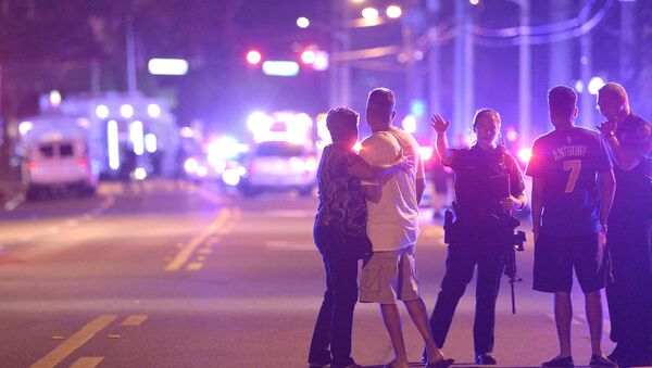 Orlando Police officers direct family members away from a multiple shooting at a nightclub in Orlando, Fla., Sunday, June 12, 2016 - Sputnik International