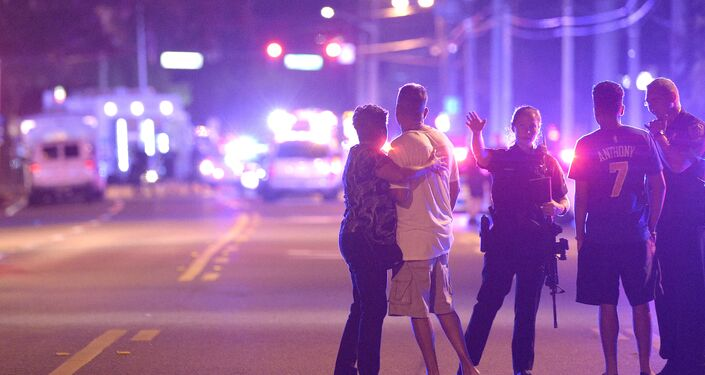 Orlando Police officers direct family members away from a multiple shooting at a nightclub in Orlando, Fla., Sunday, June 12, 2016