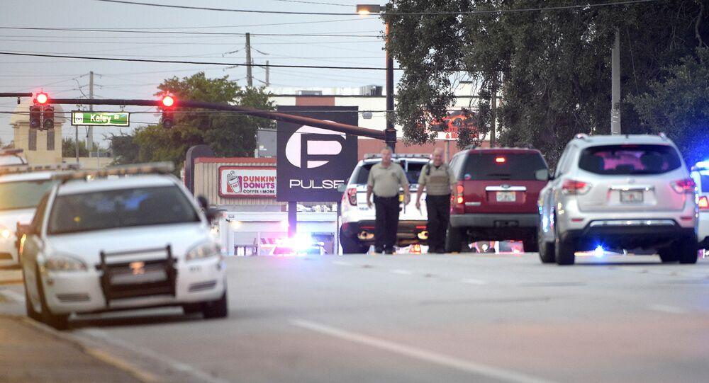 Police cars surround the Pulse Orlando nightclub, the scene of a fatal shooting, in Orlando, Fla., Sunday, June 12, 2016