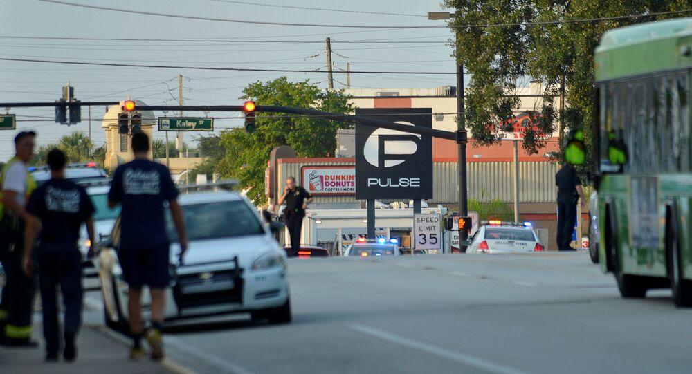 Police lock down Orange Avenue around Pulse nightclub, where people were killed by a gunman in a shooting rampage in Orlando, Florida June 12, 2016