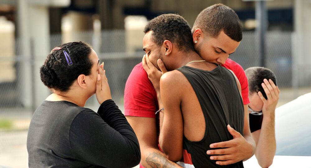 Friends and family members embrace outside the Orlando Police Headquarters during the investigation of a shooting at the Pulse night club, where as many as 20 people have been injured after a gunman opened fire, in Orlando, Florida, U.S June 12, 2016