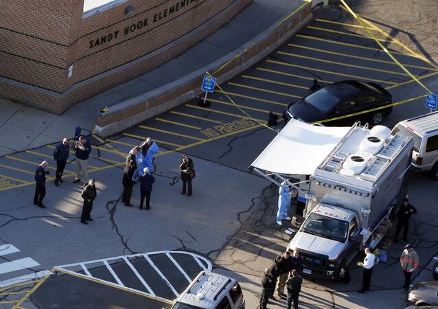 Officials on the scene outside Sandy Hook Elementary School in Newtown, Connecticut elementary school following a shooting that left 27 people dead, including 20 children, 14 December 2012