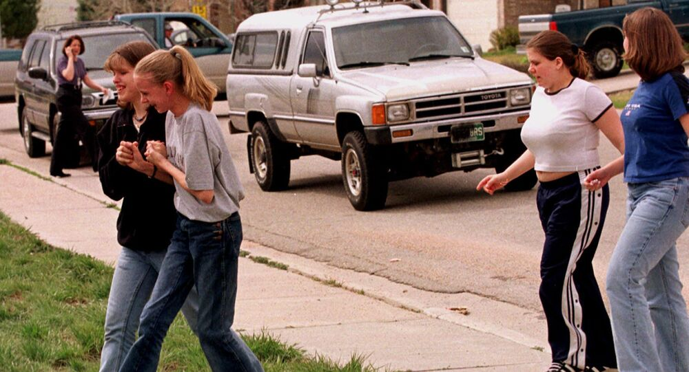 Students from Columbine High School are led away from the facility after two gunmen went on a shooting rampage Tuesday, April 20, 1999, in the southwest Denver suburb of Littleton, Colo.