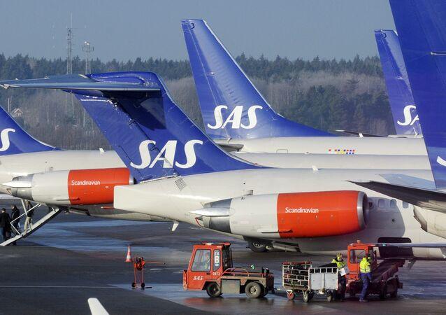 SAS aircraft are seen parked at the gates at Terminal 4 of Arlanda Airport near Stockholm