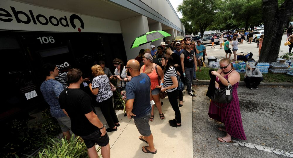 Hundreds of community members line up outside a clinic to donate blood after an early morning shooting attack at a gay nightclub in Orlando, Florida, U.S June 12, 2016