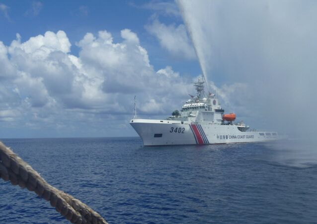 Chinese Coast Guard members off Scarborough Shoal in the South China Sea. file photo