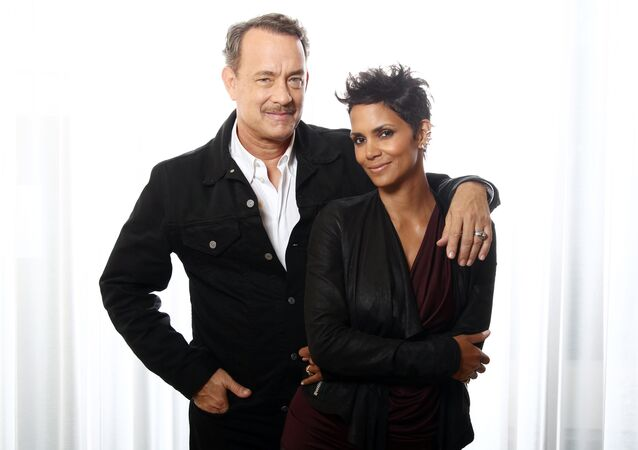 Actors Tom Hanks, left, and Halle Berry, from the upcoming film Cloud Atlas, pose for a portrait in Beverly Hills, California.