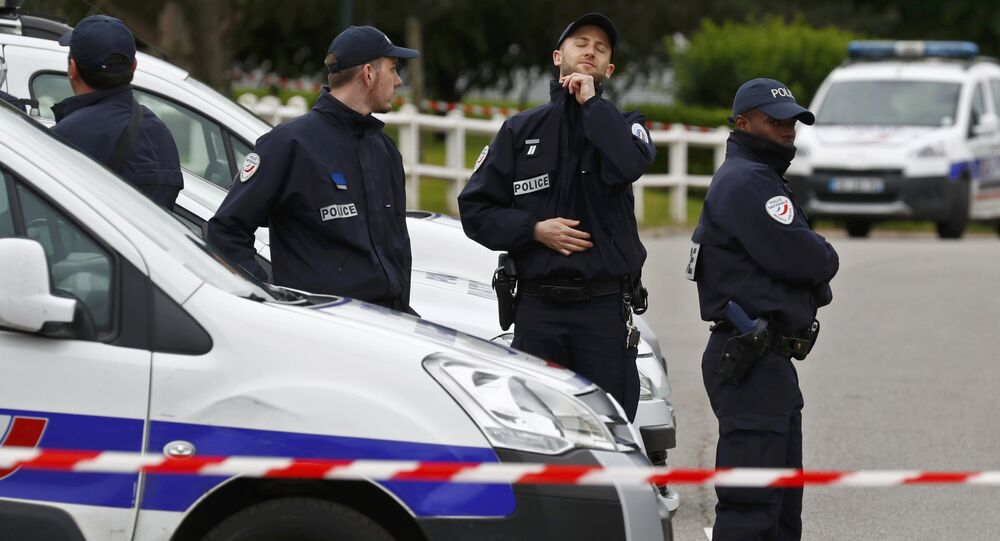 Police man a roadblock at the scene where a French police commander was stabbed to death in front of his home in the Paris suburb of Magnanville, France, June 14, 2016.